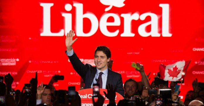 Justin Trudeau waving hand during in his speech at election campaign