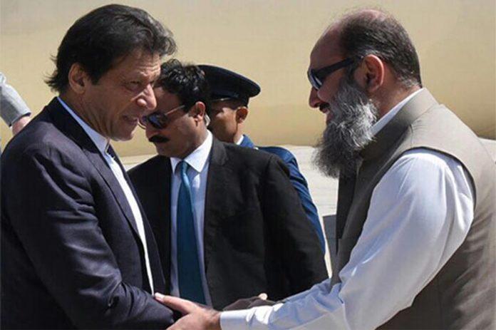 PM Imran Khan and Balochistan Chief Minister Jam Kamal shaking hands